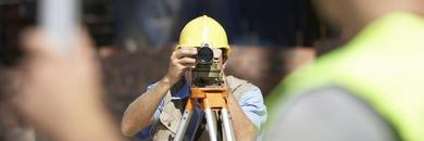 Professional land surveyor on construction site in Los Angeles